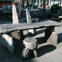 7. Chairs and tables in mixed wood on Gabriel's Wharf